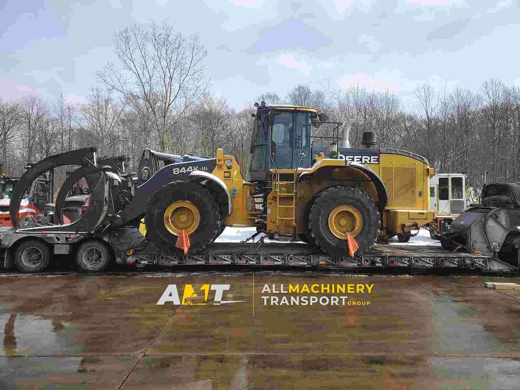 Deere 844K Wheel Loader loaded for transport