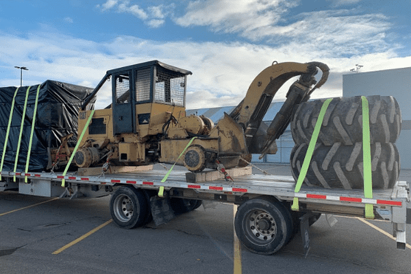 the-cat-518-skidder-hauled-across-usa-canada-mexico