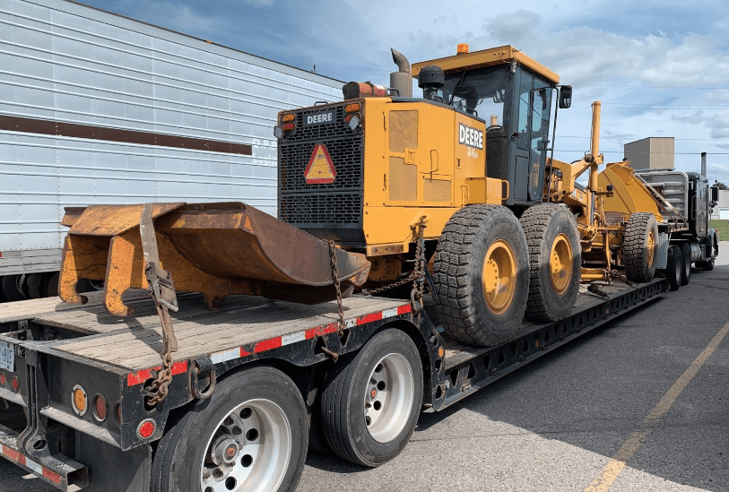 Deere-772-Grader-on-truck-Canada-USA