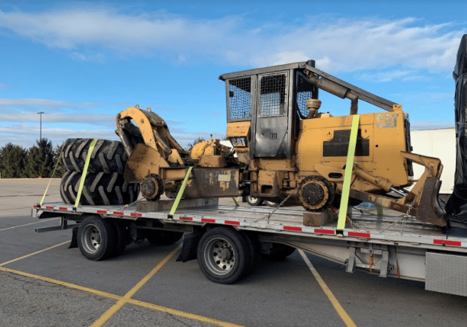 The CAT 518 Skidder being transported across USA - Canada.