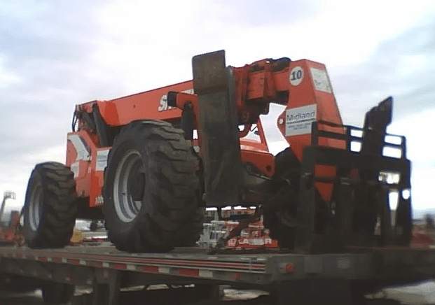 Affordable Trucking Company across the USA, Canada and Mexico transporting equipment like backhoes, cranes and heavy loads.